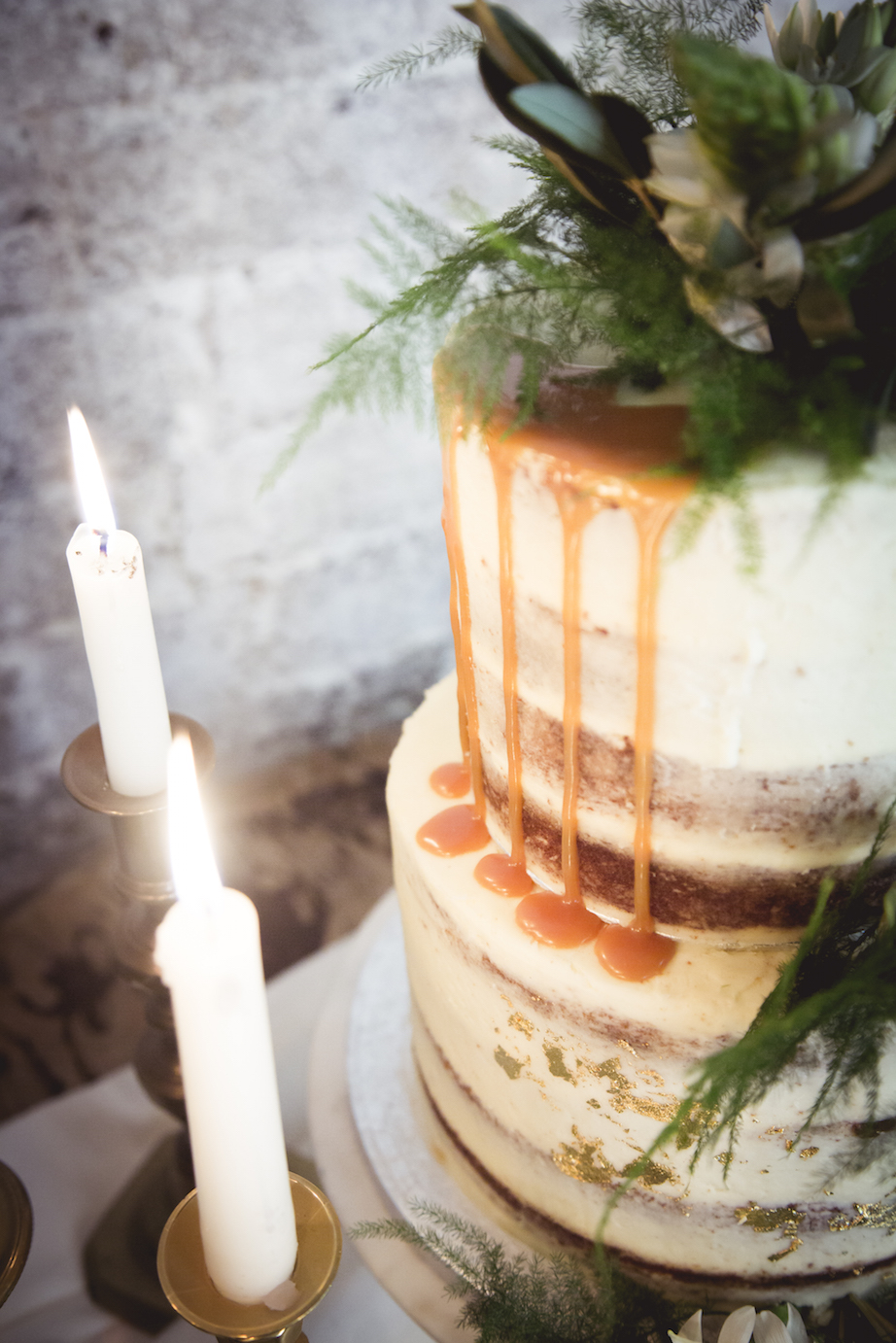 semi naked cake with fern and greenery decoration
