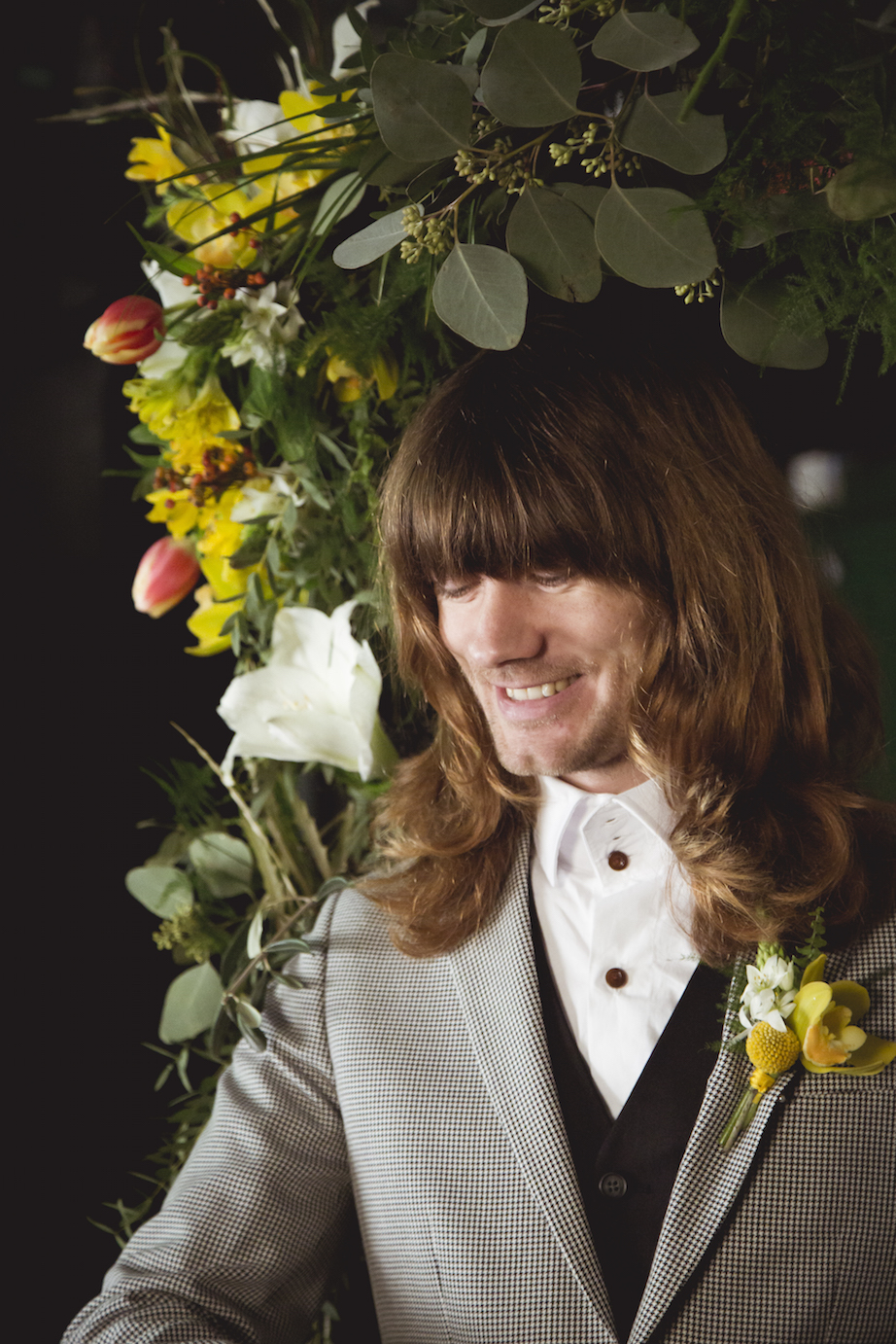 groom and yellow buttonhole grey suit