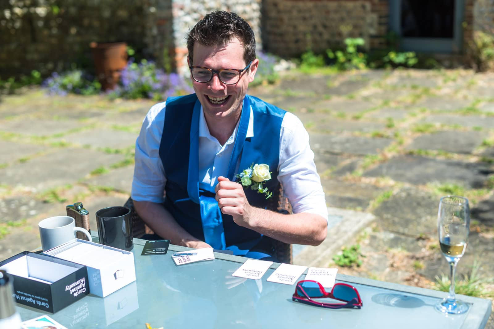 white rose and blue flower buttonhole, Sussex wedding florist
