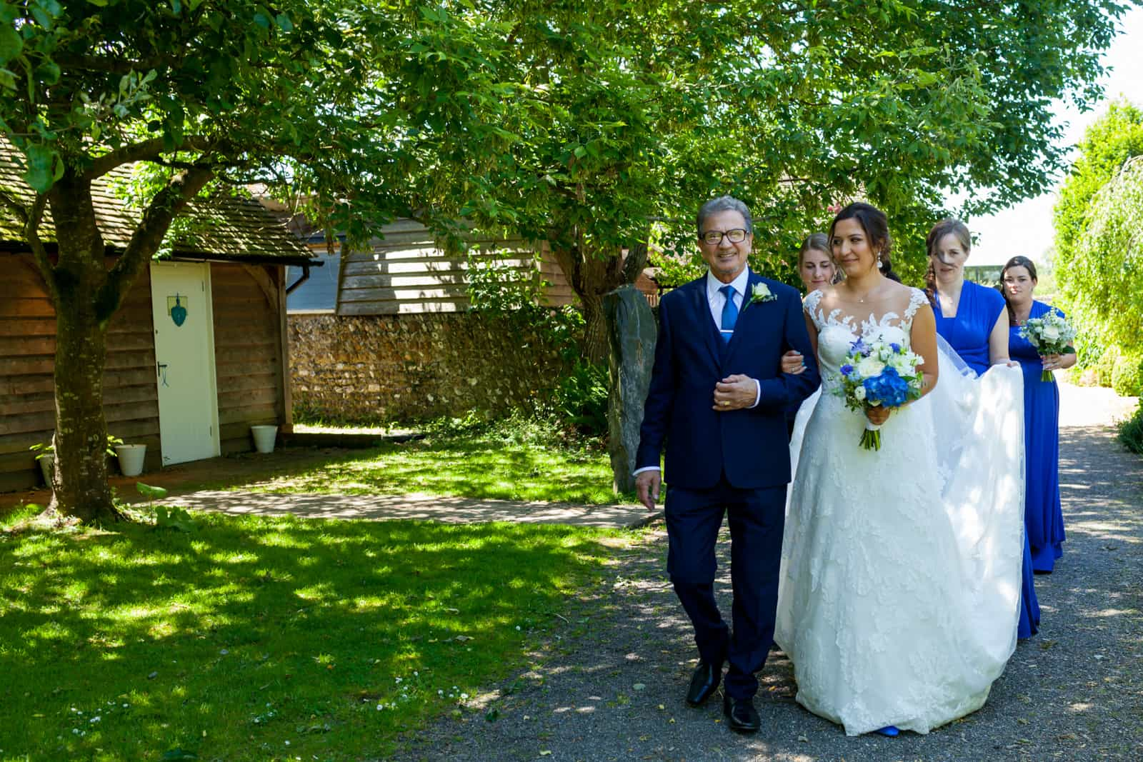 bride and her blue and white bouquet at The English Wine Centre East Sussex