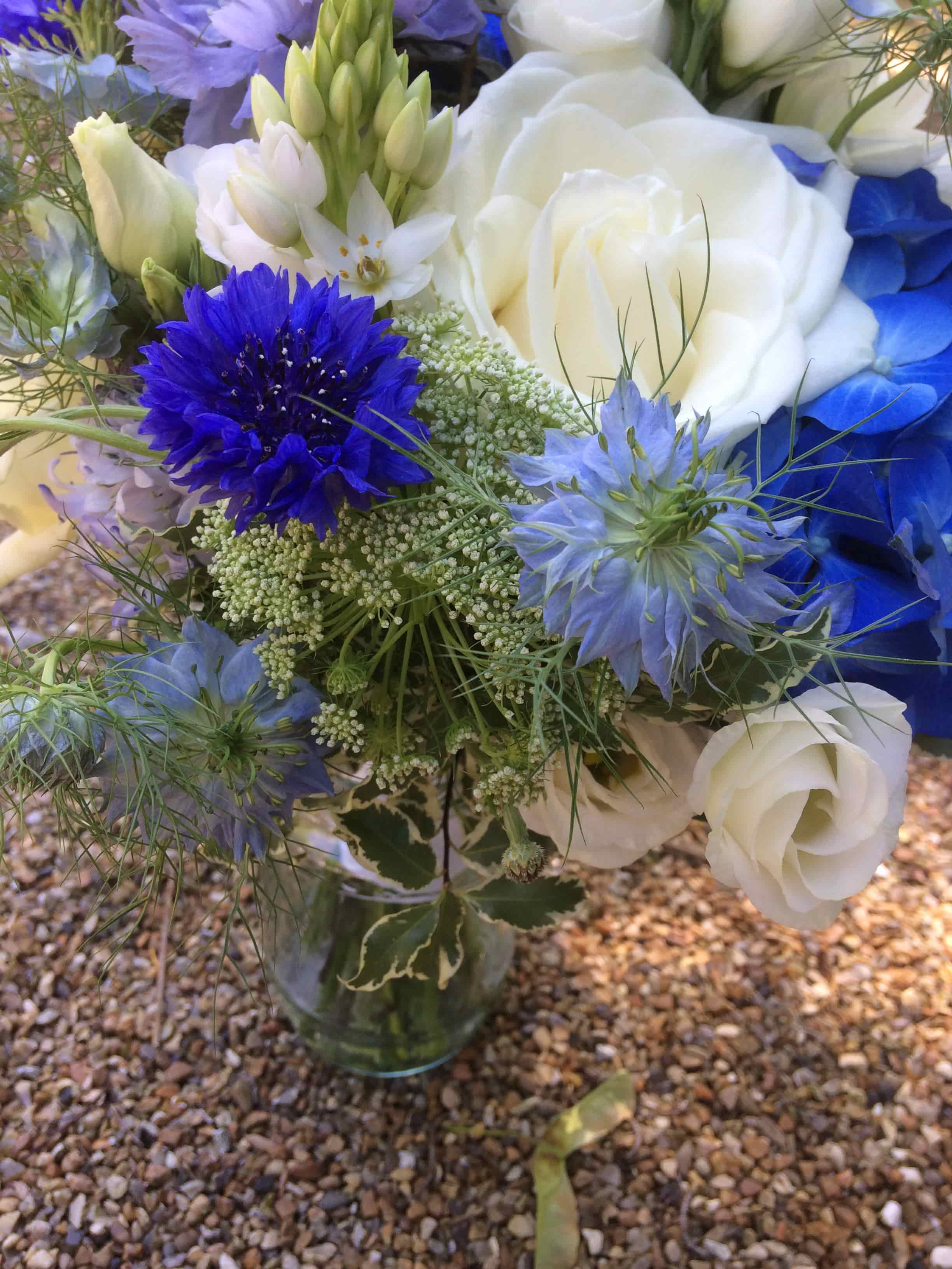 Blue and white bridesmaids bouquet at The English Wine Centre, East Sussex