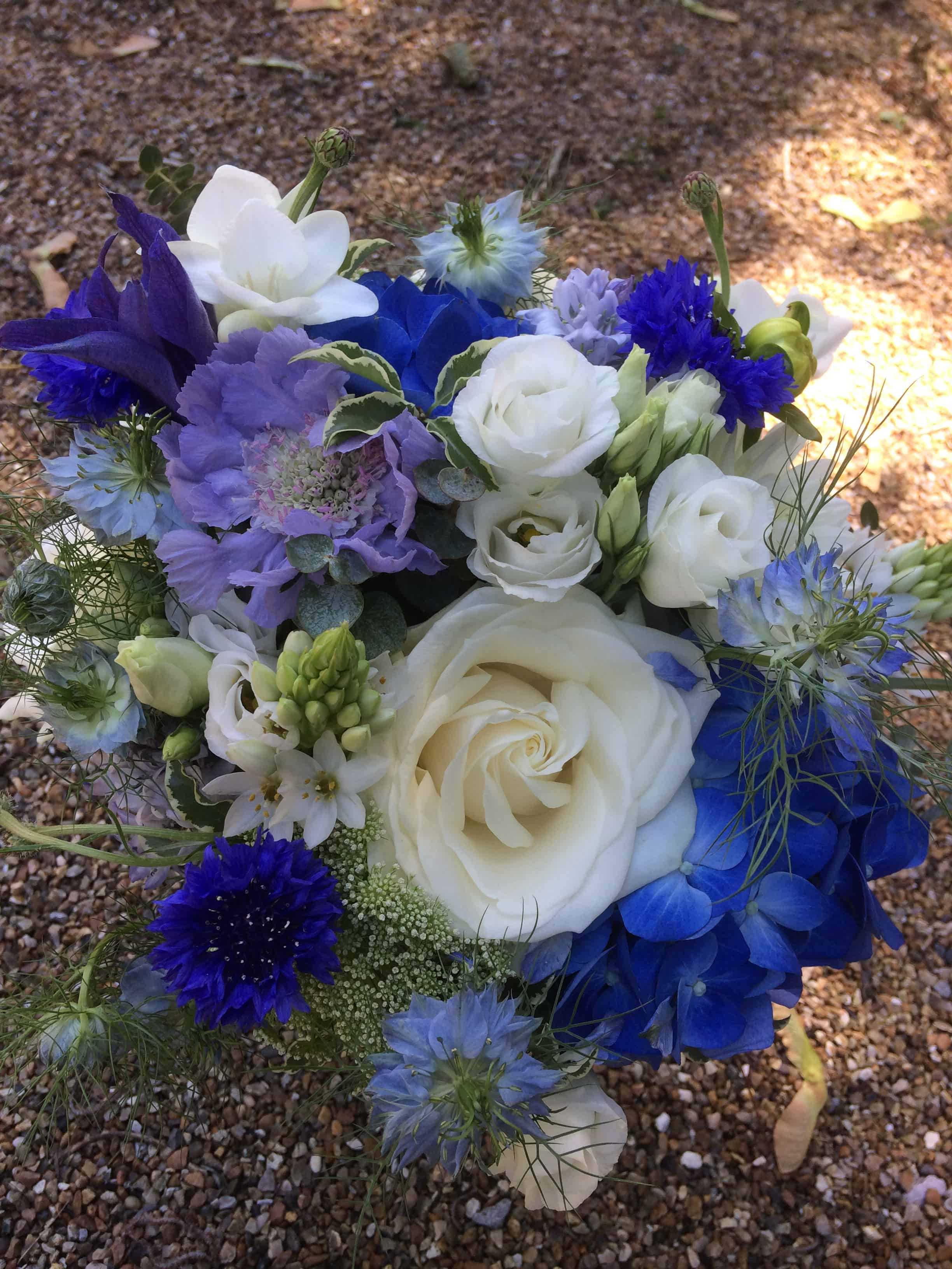Blue and white summer bridal bouquet at The English Wine Centre, East Sussex