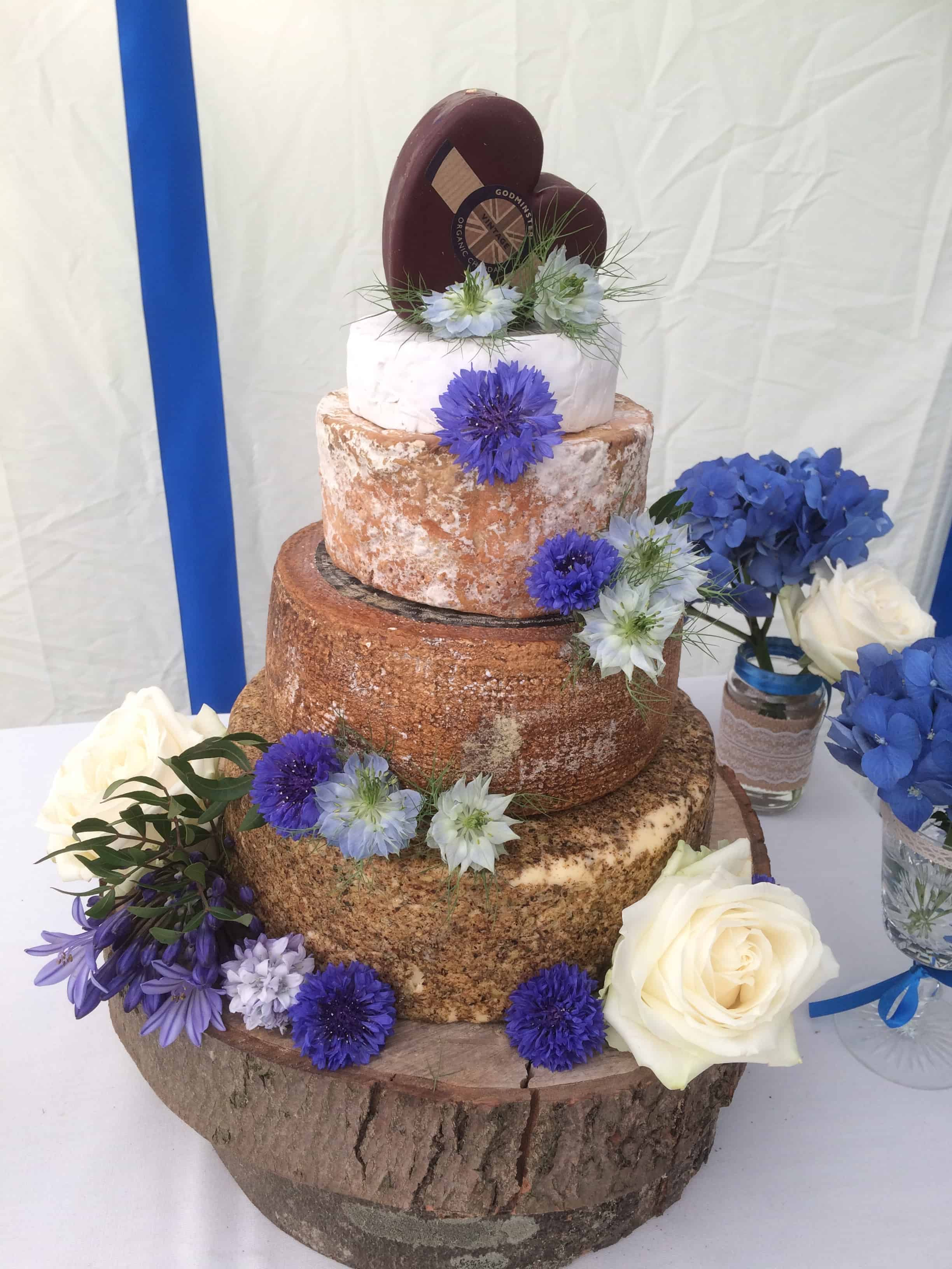 Blue and white flowers on a cheese cake at The English Wine Centre