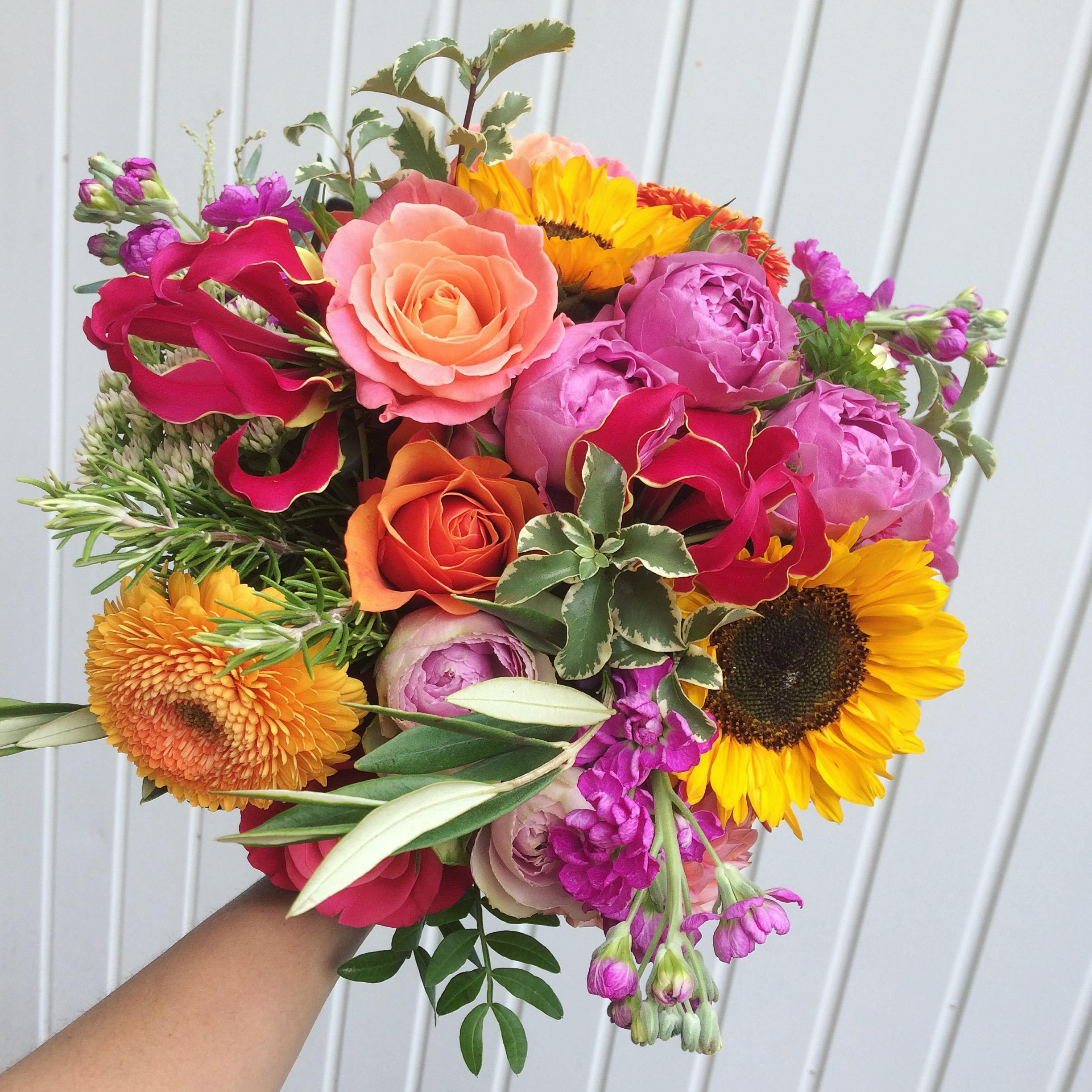 hot cerise pink and yellow bridal bouquet with sunflowers