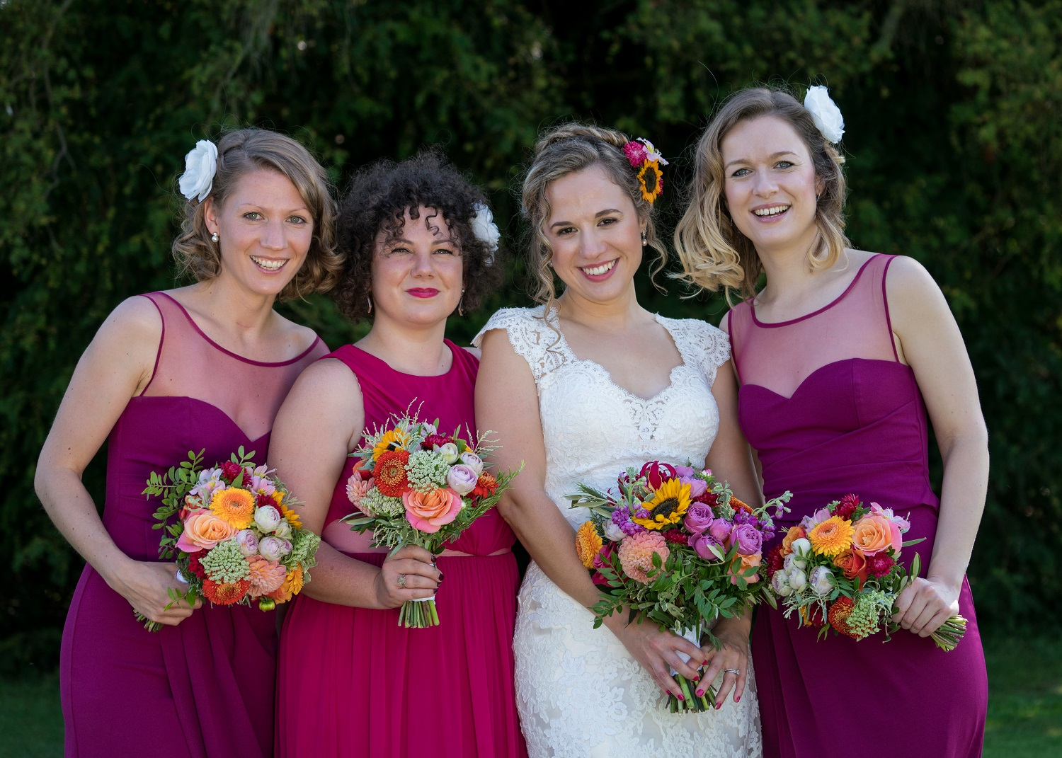 wakehurst place wedding, colourful wedding bouquets with cerise pink bridesmaids dresses