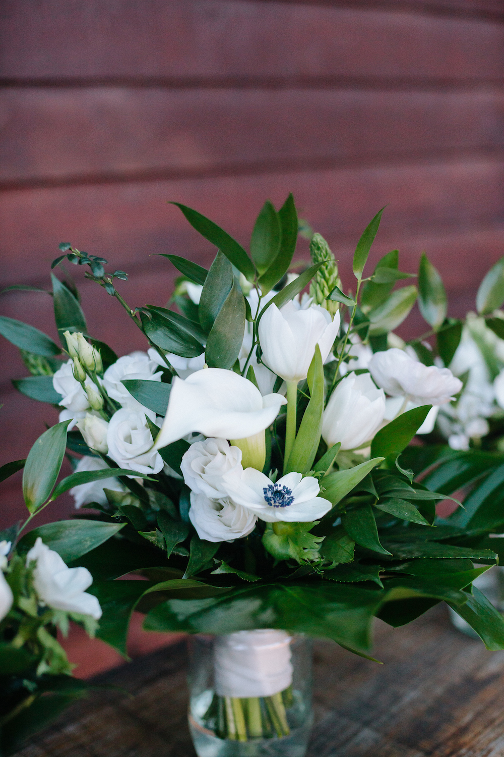 white winter bridesmaids bouquets with tulips, anemones, lisianthus and bouvardia