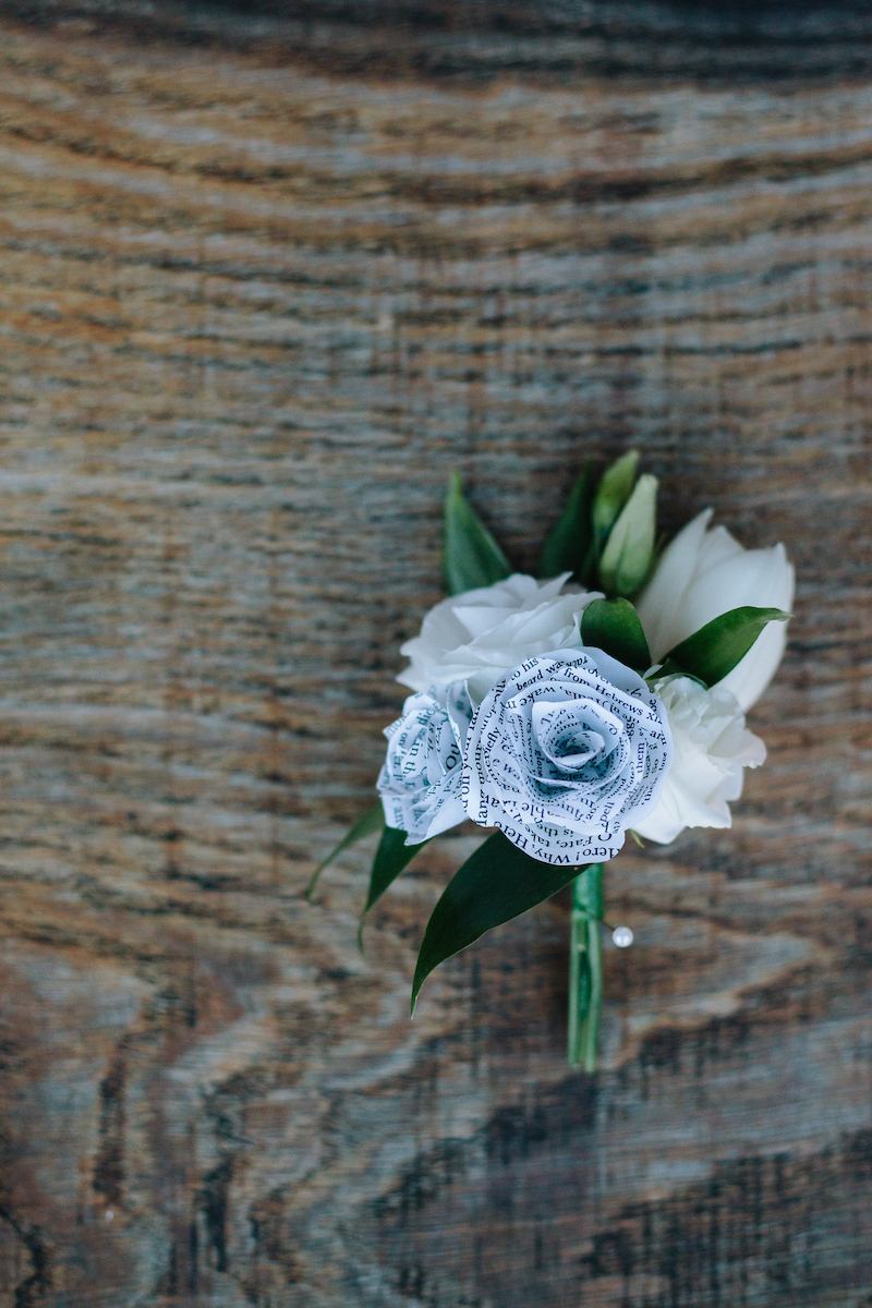 buttonholes with handmade paper roses and real flowers