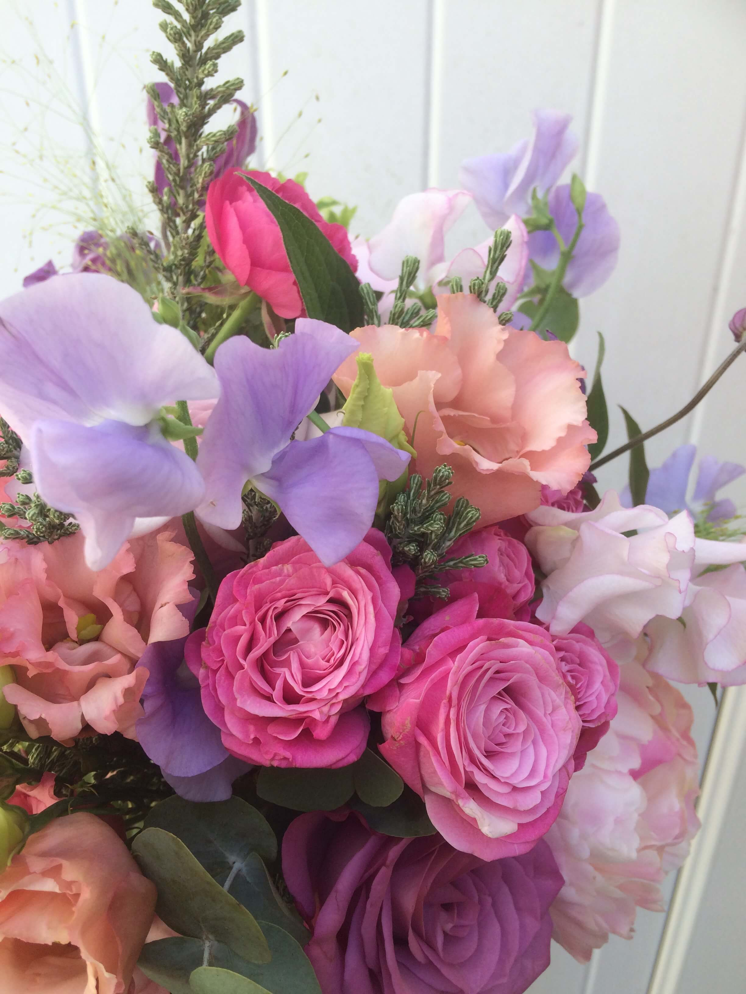 lilac sweet peas in bridal bouquet at Pangdean barn in Brighton