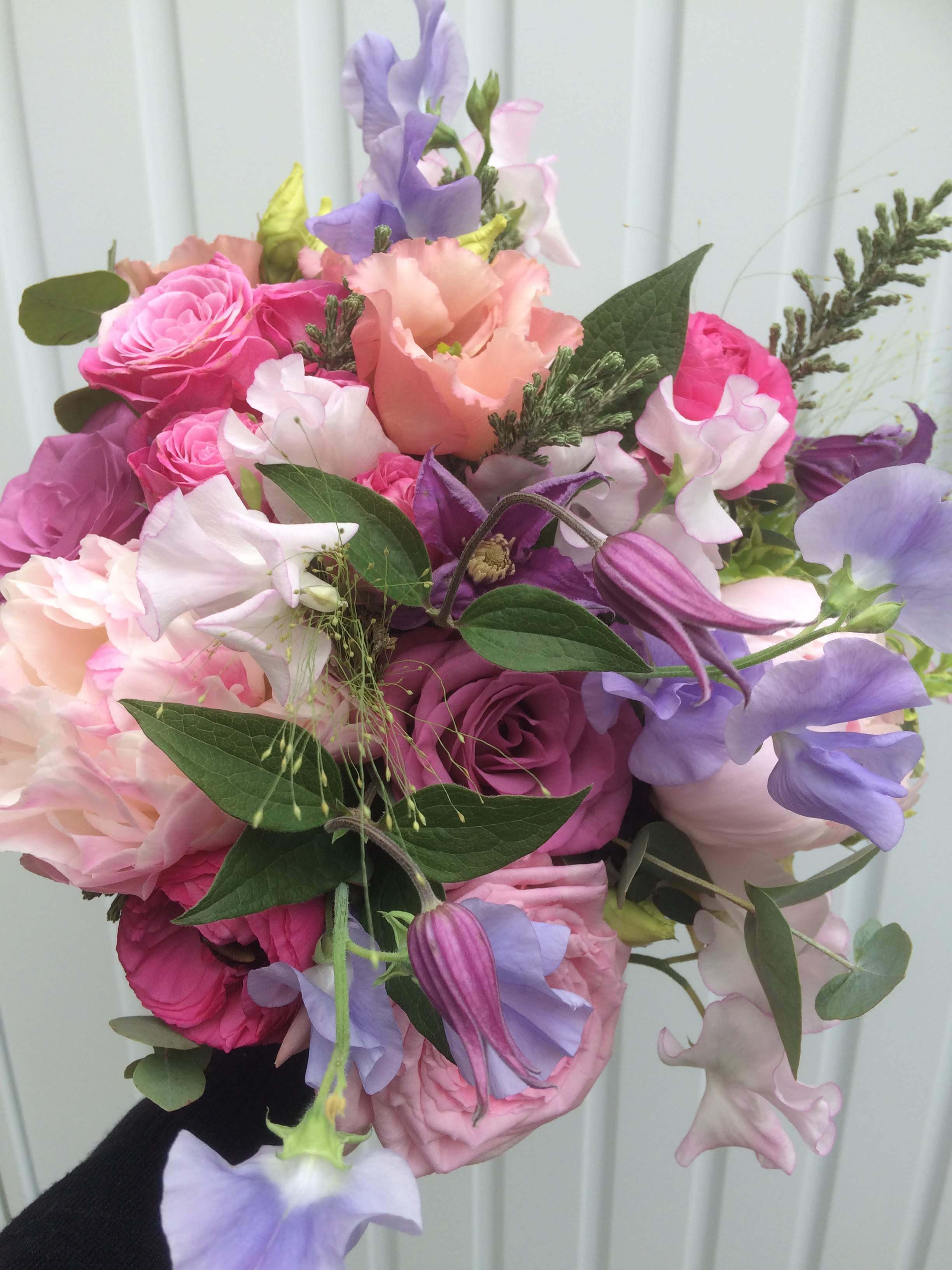 pink and purple bouquet with peonies, roses, sweet peas, clematis and lisianthus