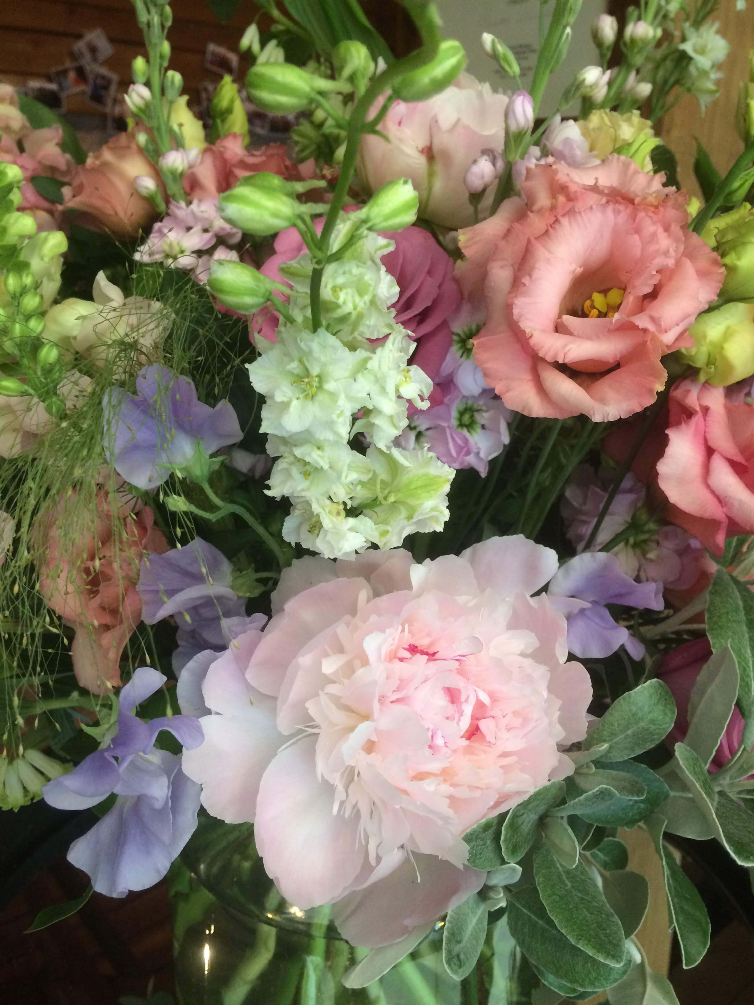 welcome vase with peonies, stocks and sweetpeas at Sussex Barn wedding