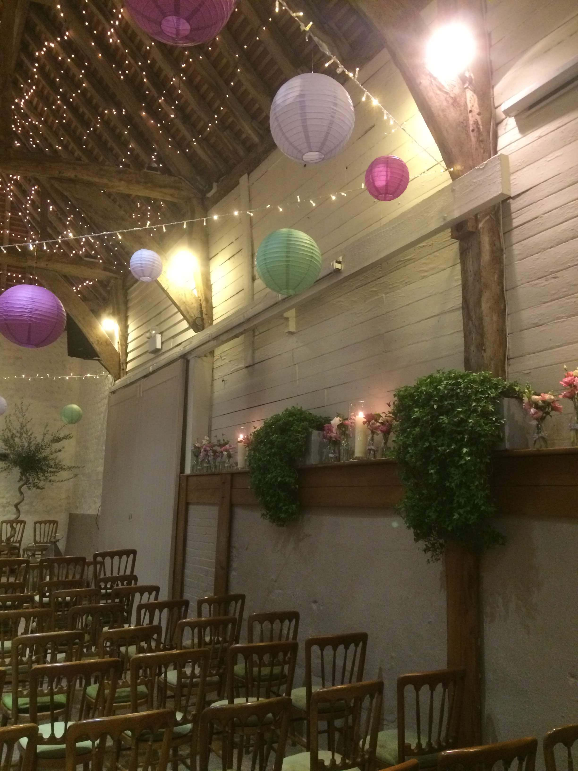 pangdean barn with hanging lanterns and flowers