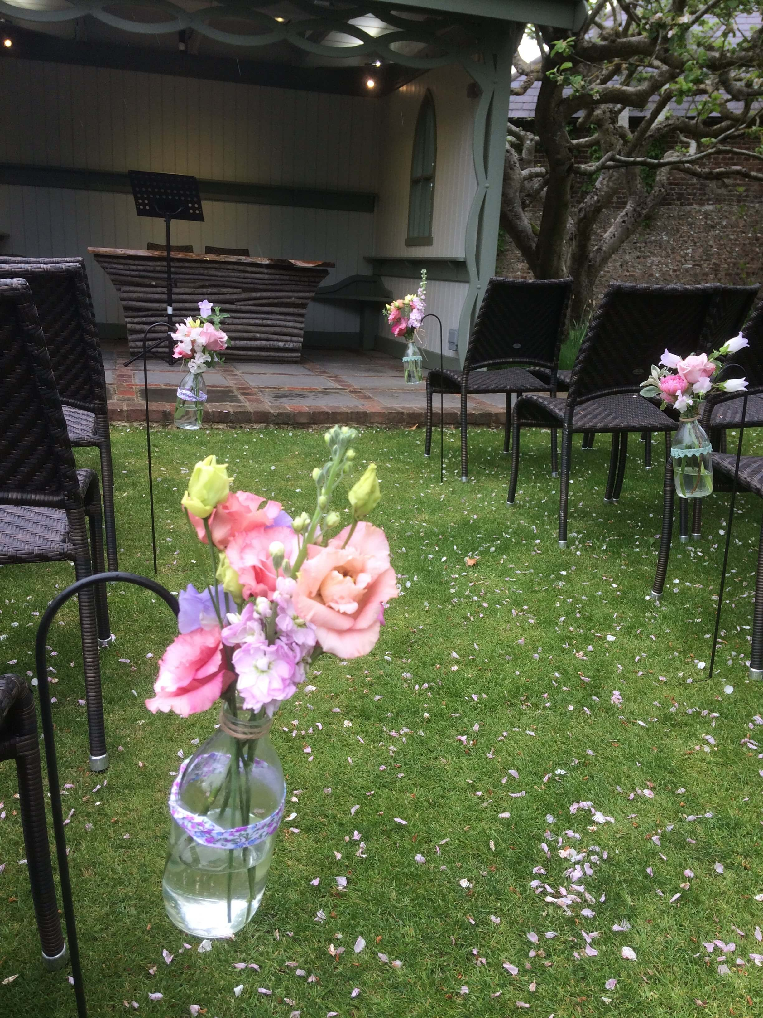 milk bottle pew ends for outdoor wedding at Pangdean Barn, East Sussex