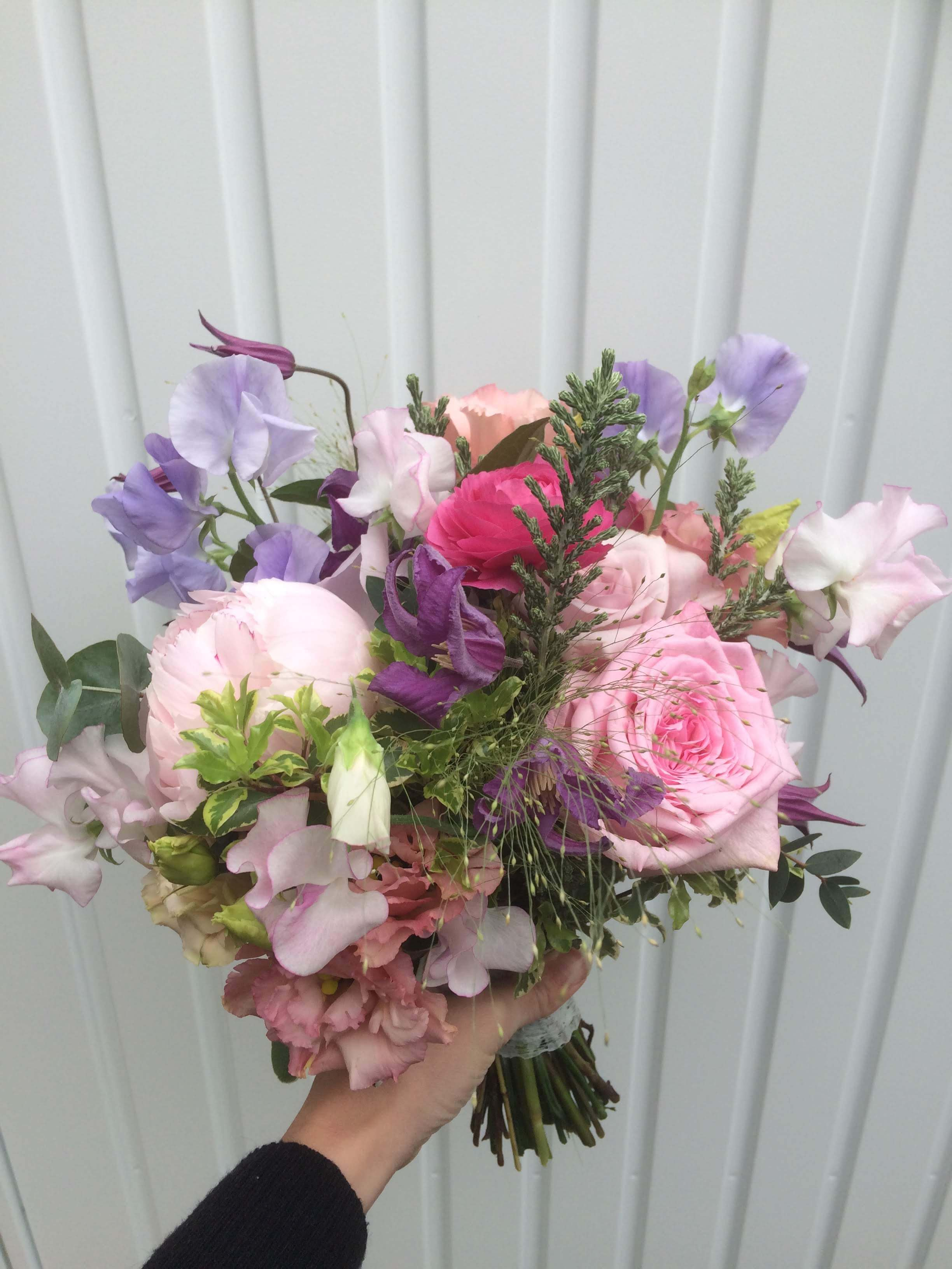 pale pink and lilac bridal bouquet for May wedding at Pangdean Barn