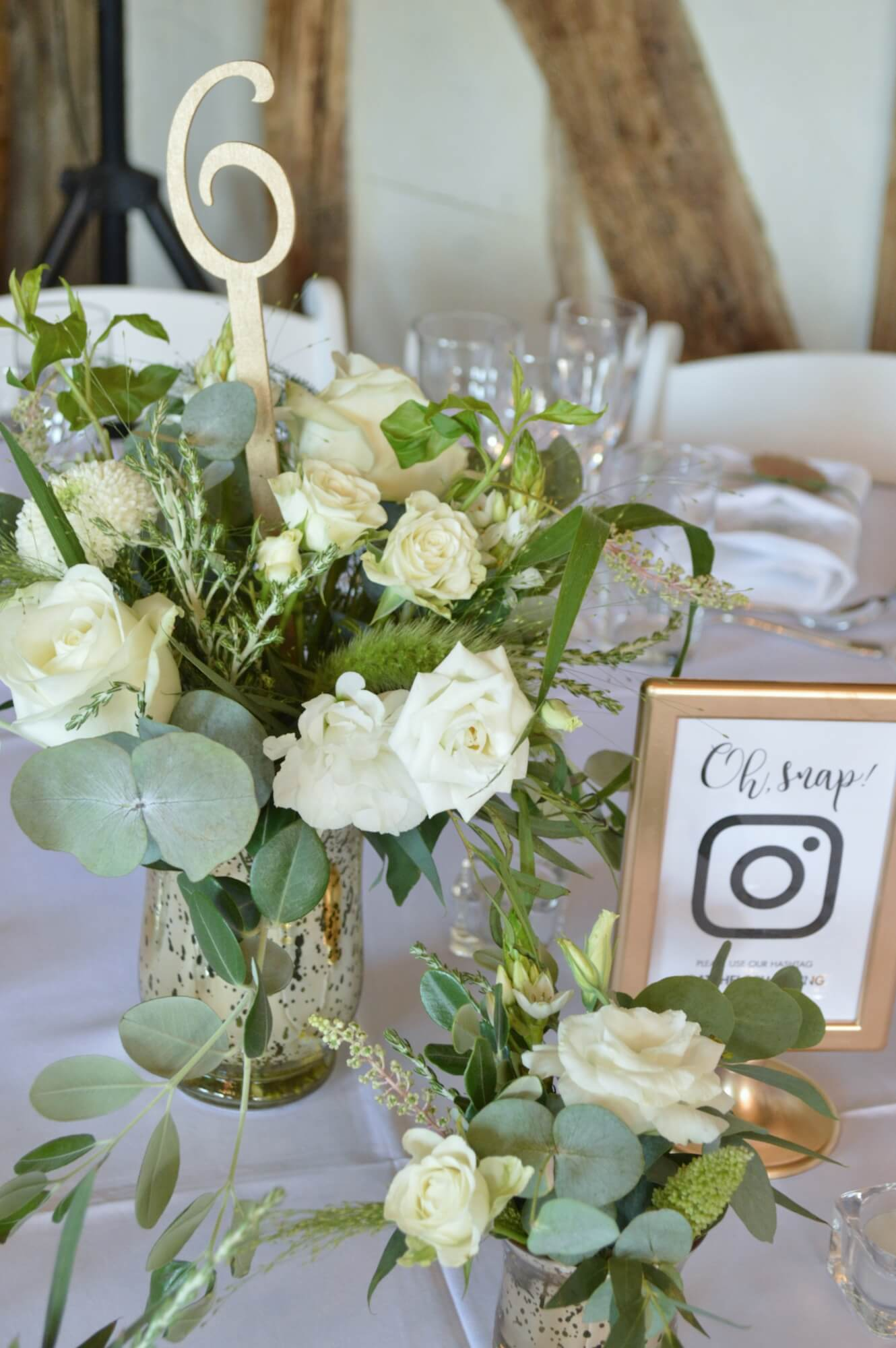 gold vase and white flowers short table centre