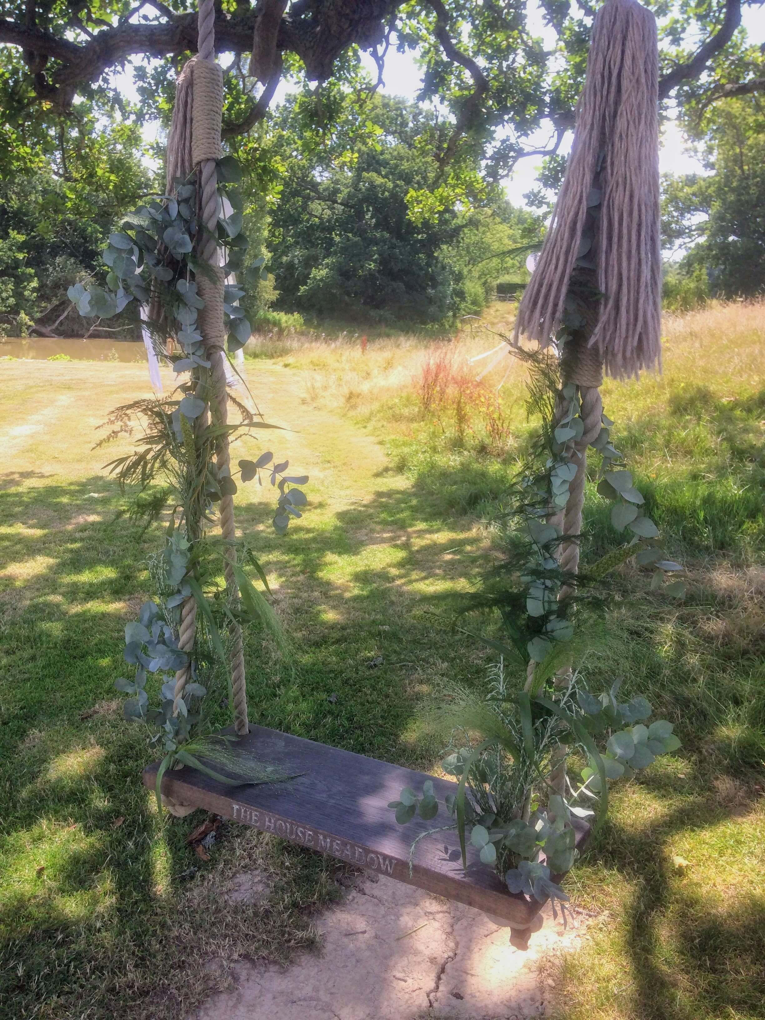 foliage decorated swing at the house meadow