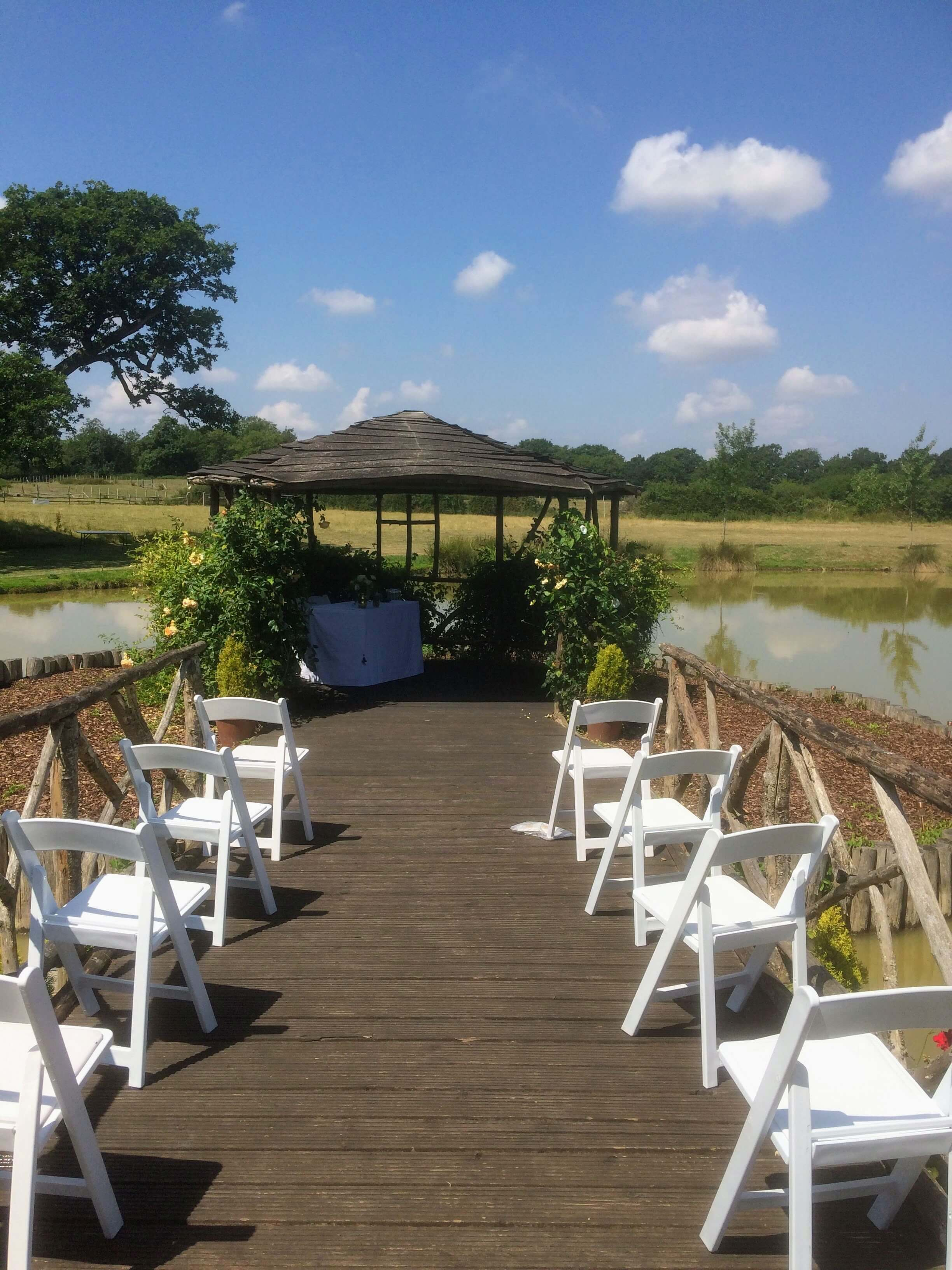 summer wedding, outdoor ceremony by the lake at the house meadow