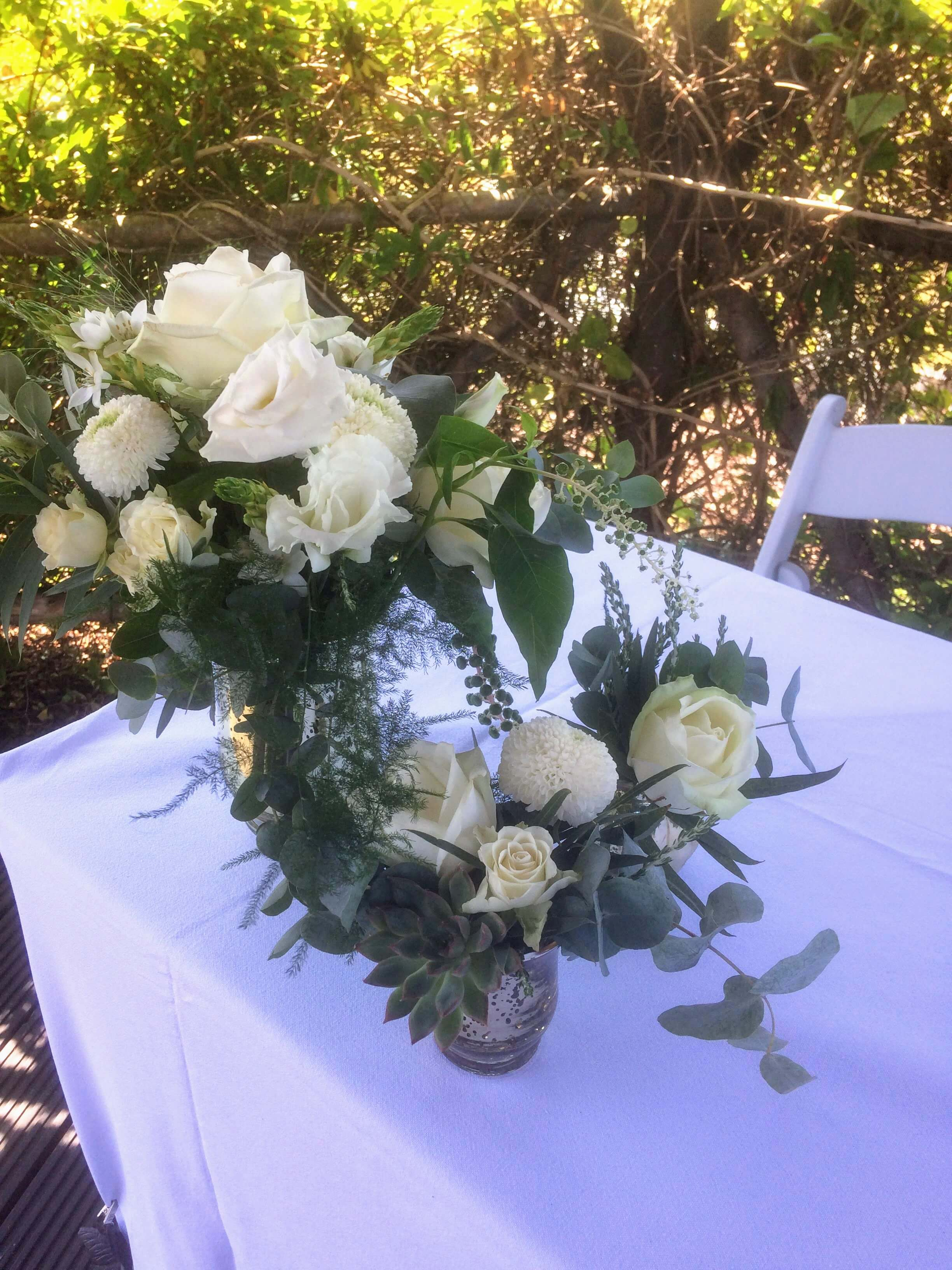 white roses an eucalyptus outdoor ceremony flowers at the house meadow