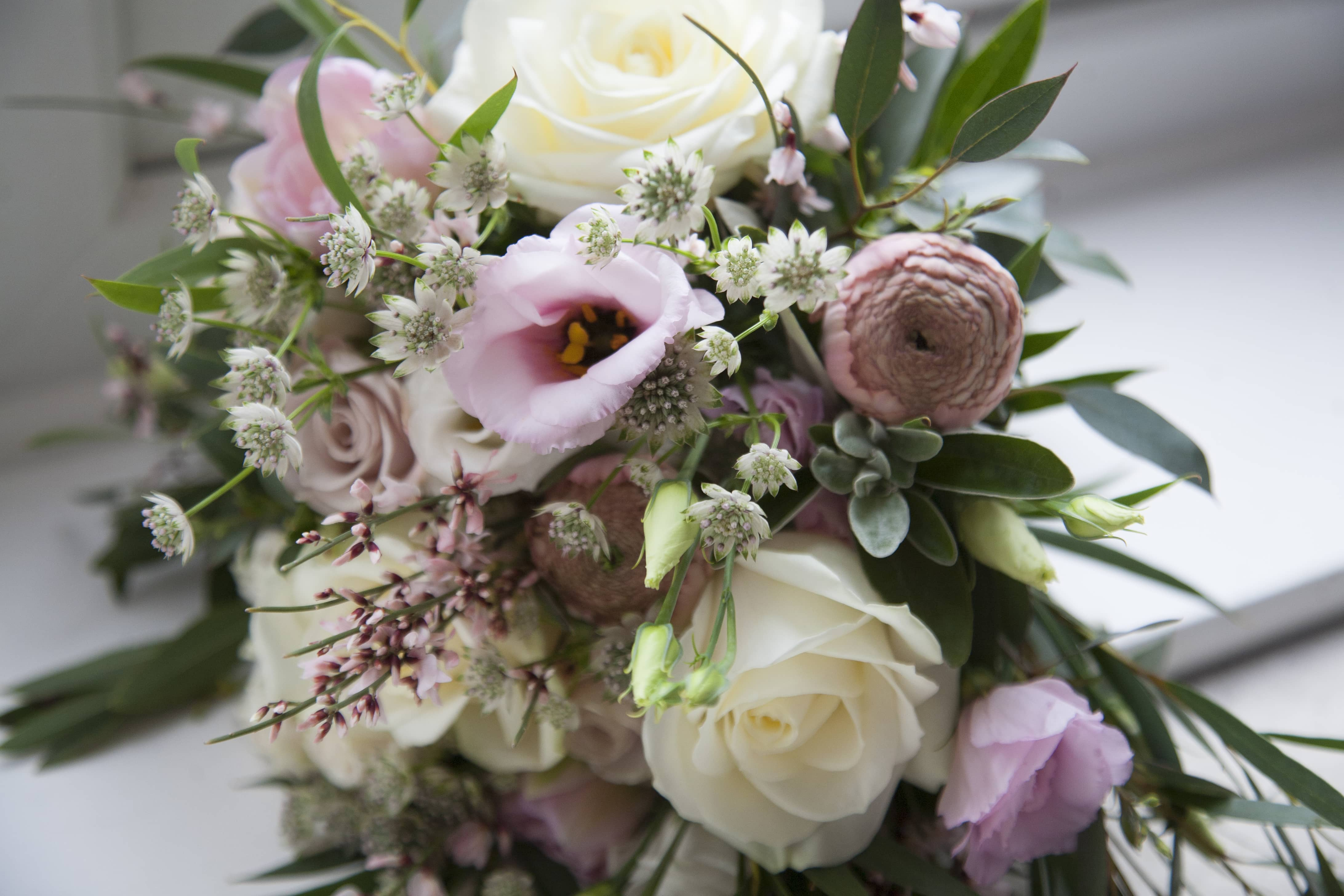 blush pink ranunculus, white roses, eucalyptus and lisianthus. April bridal bouquet.