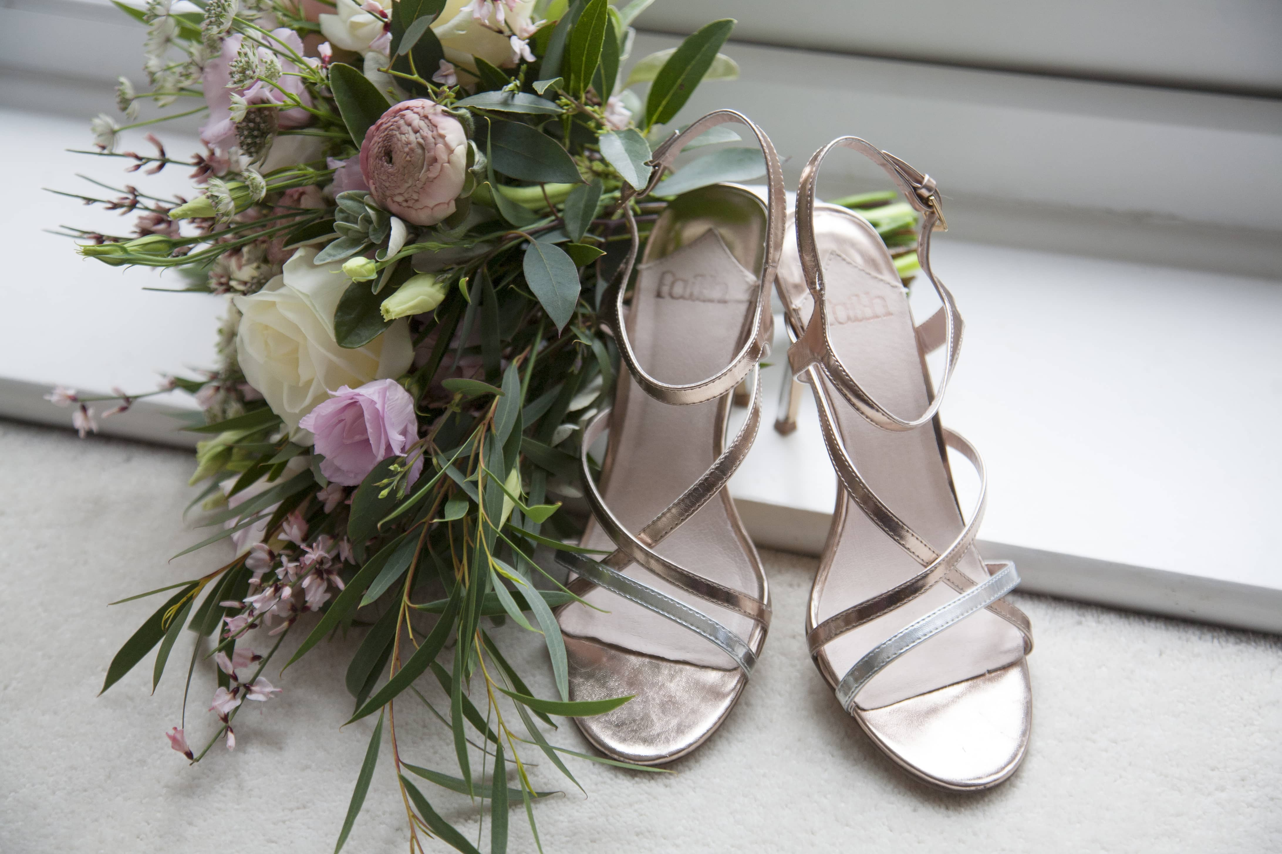 bridal bouquet and metallic rose gold shoes