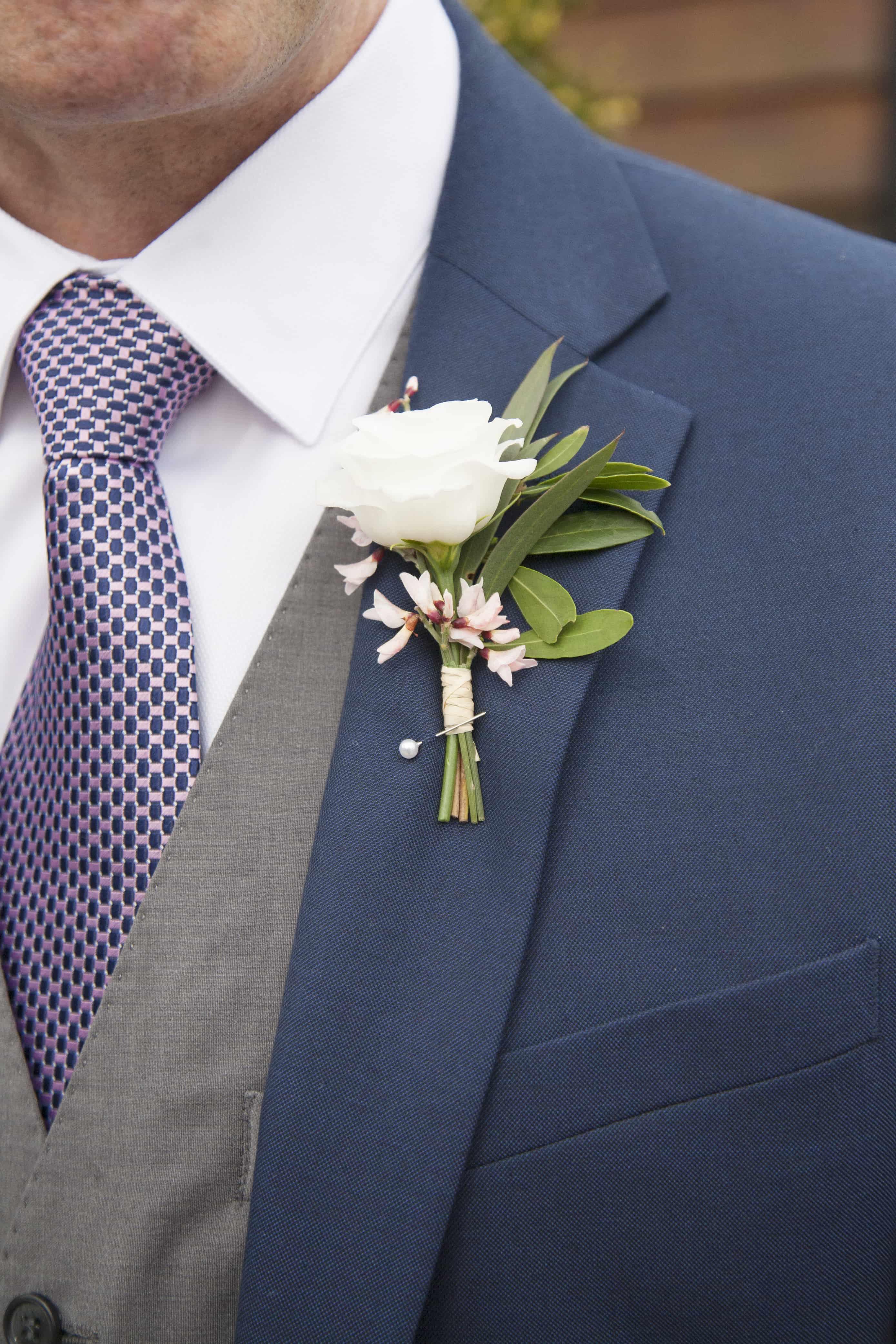 white lisianthus buttonhole, spring wedding ideas