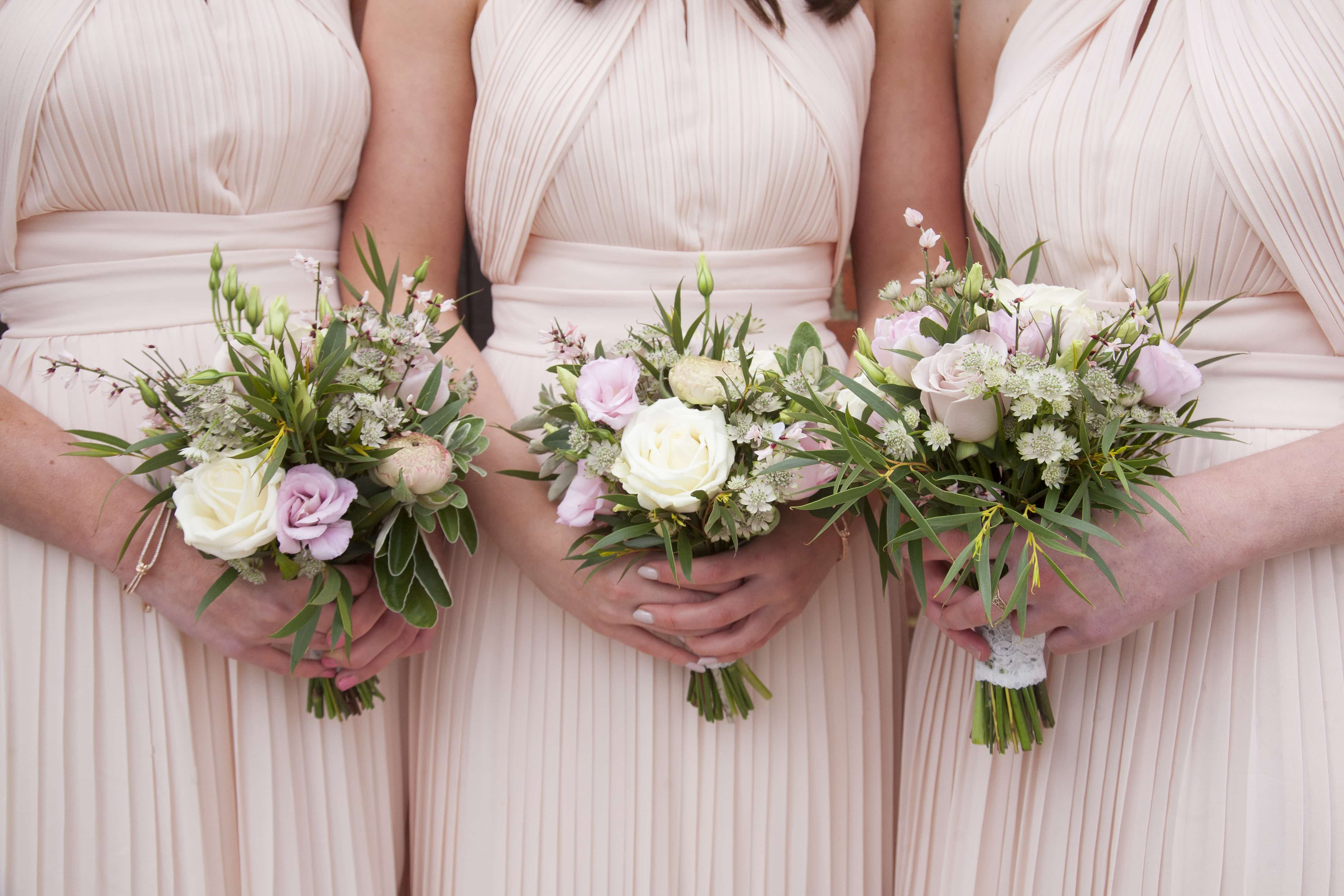 nude pink bridesmaid dresses with pink and white bridesmaids bouquets