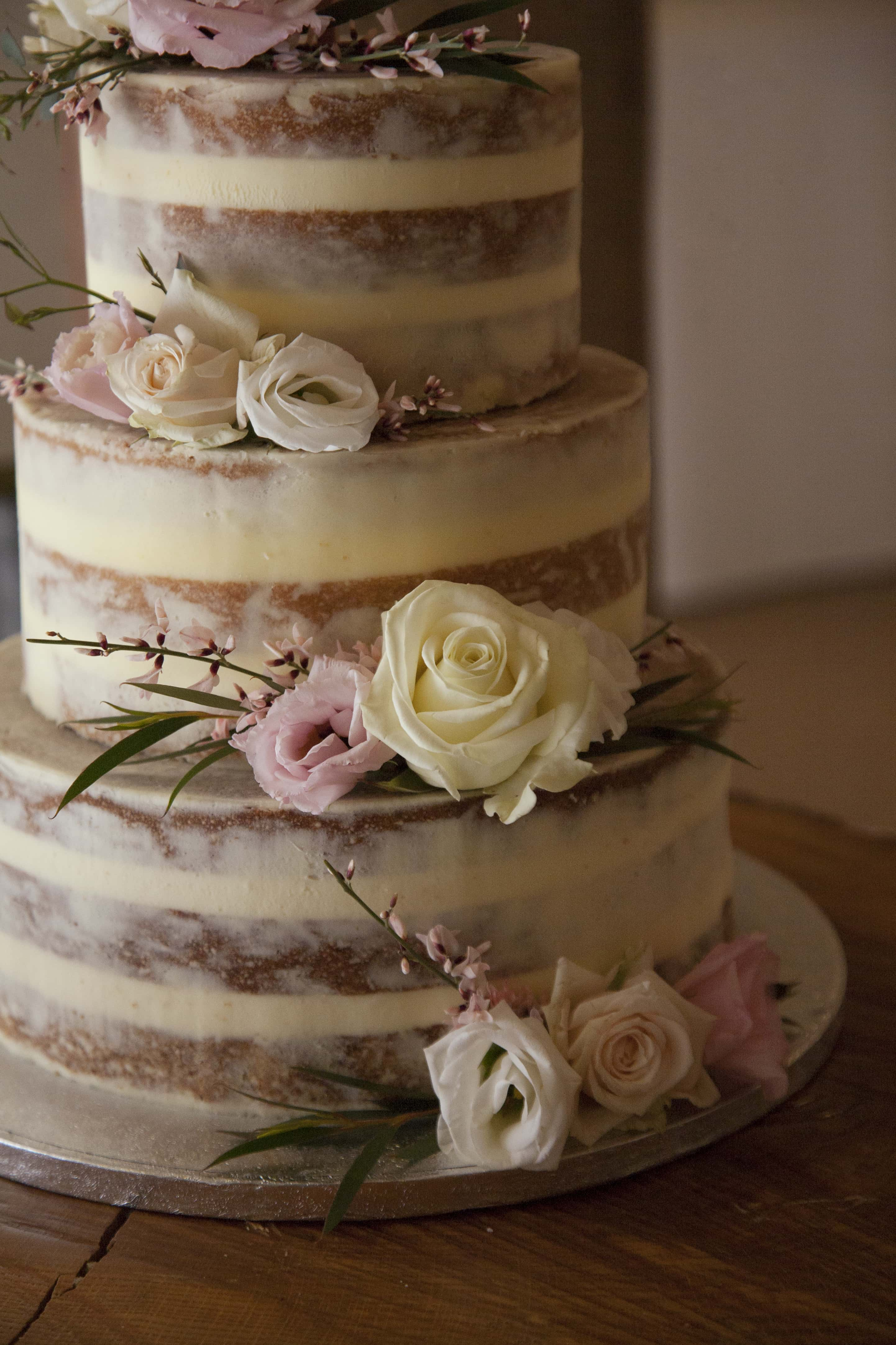 semi naked cake with blush pink and white roses