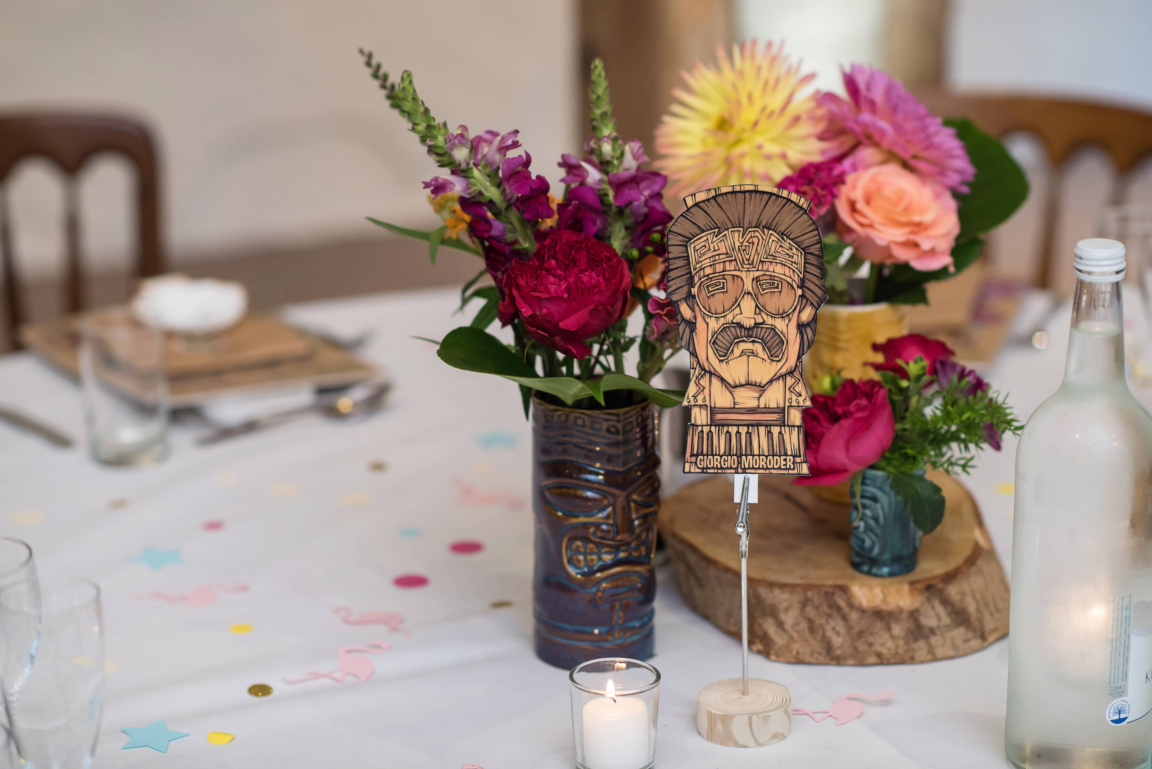 table flowers with tiki mugs