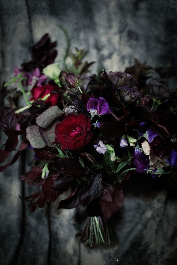black bacarra roses, black pearl lisianthus with deep purples, plums and dark reds in this gothic bridal bouquet