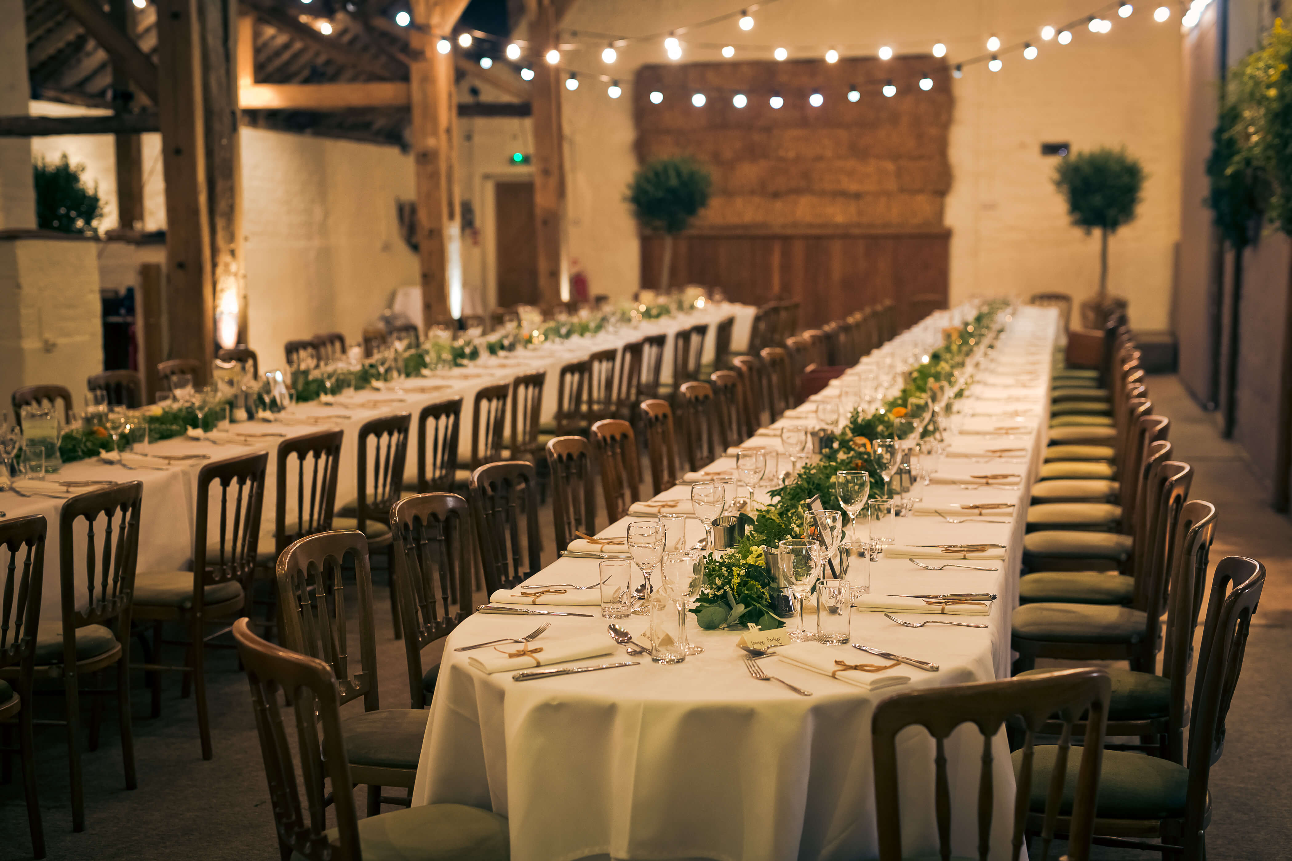 foliage garlands on long wedding tables at pangdean barn brighton