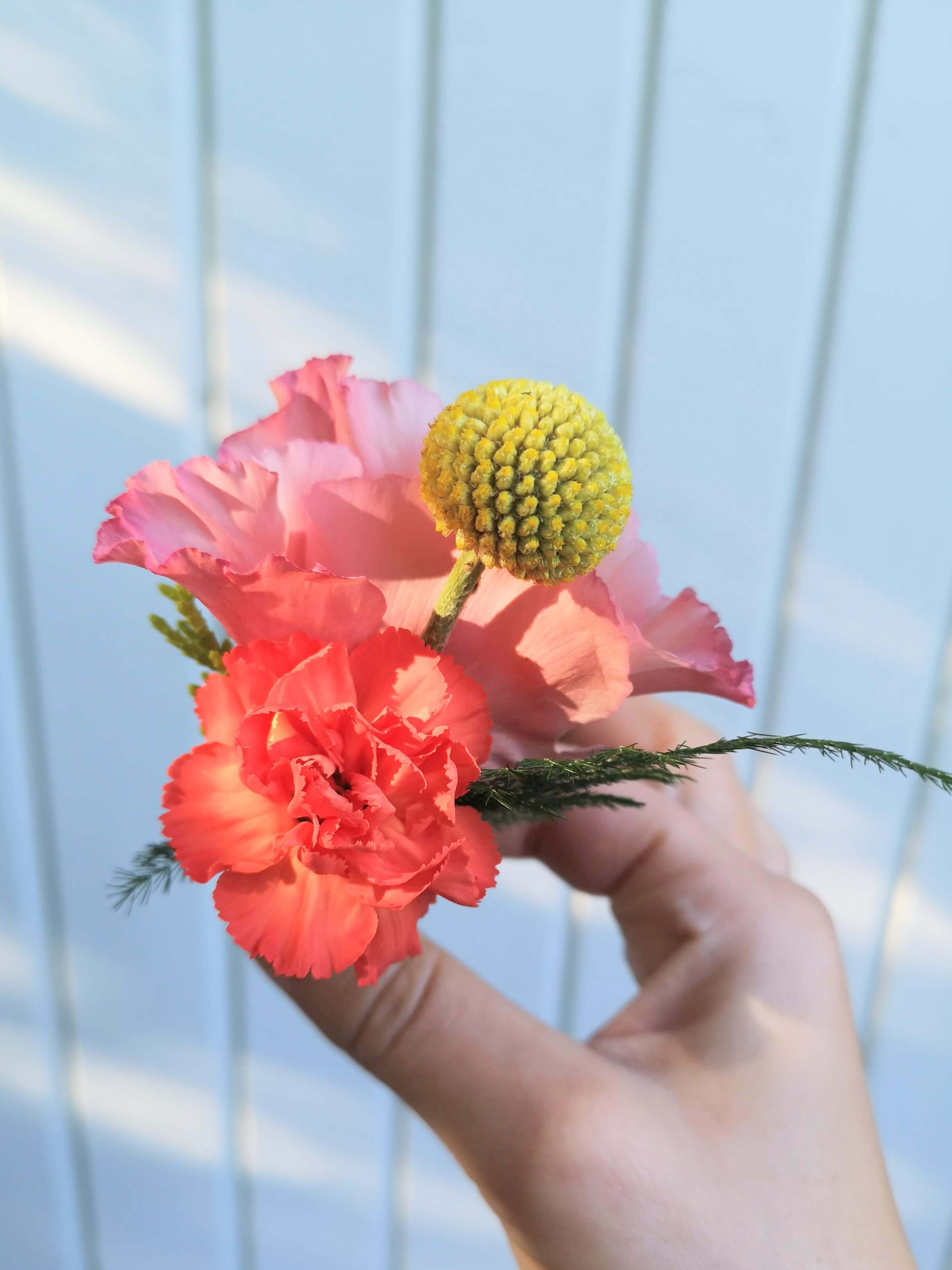 coral, pink and yellow wedding buttonholes