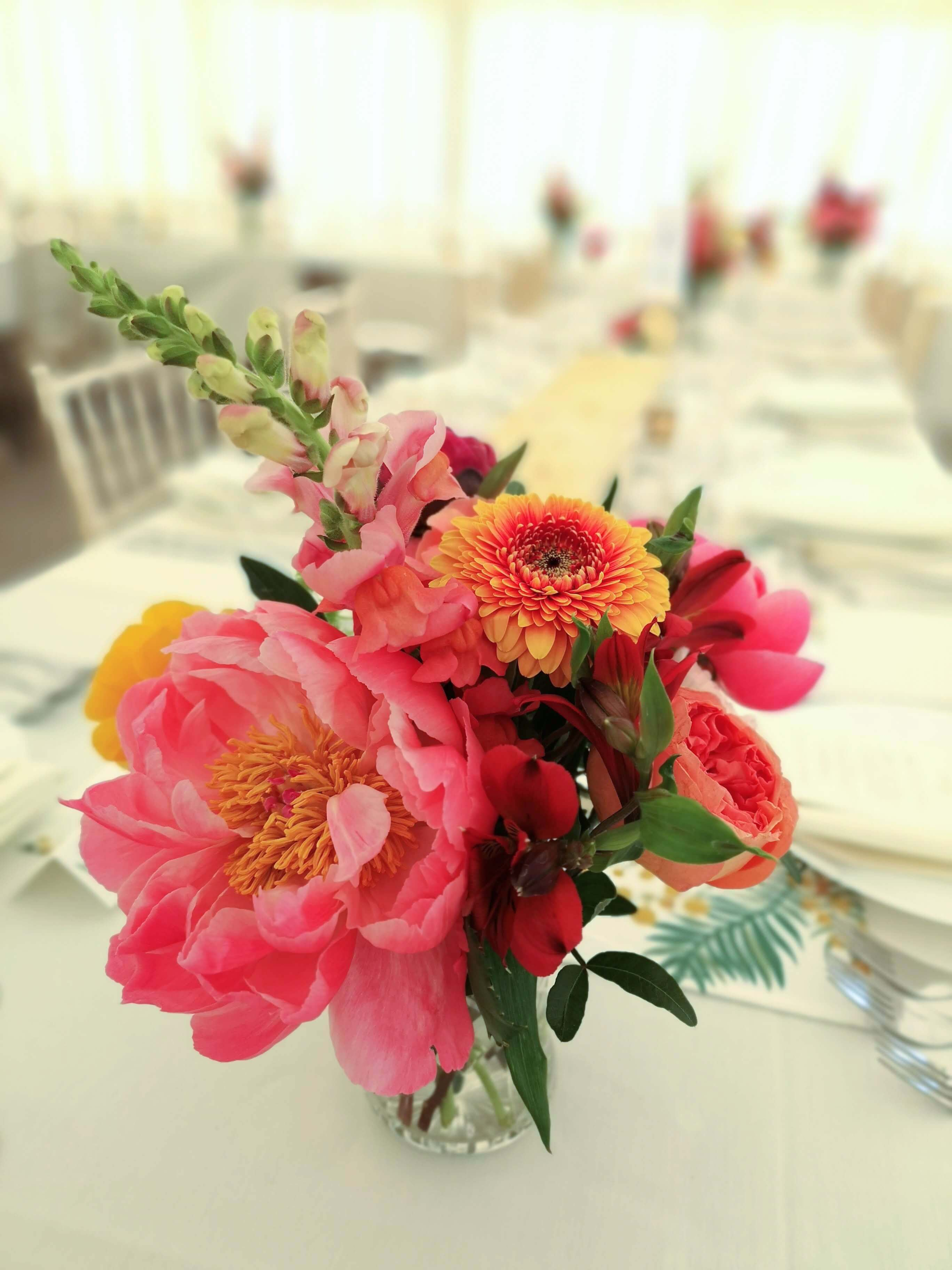 open coral charm peony wedding table centres