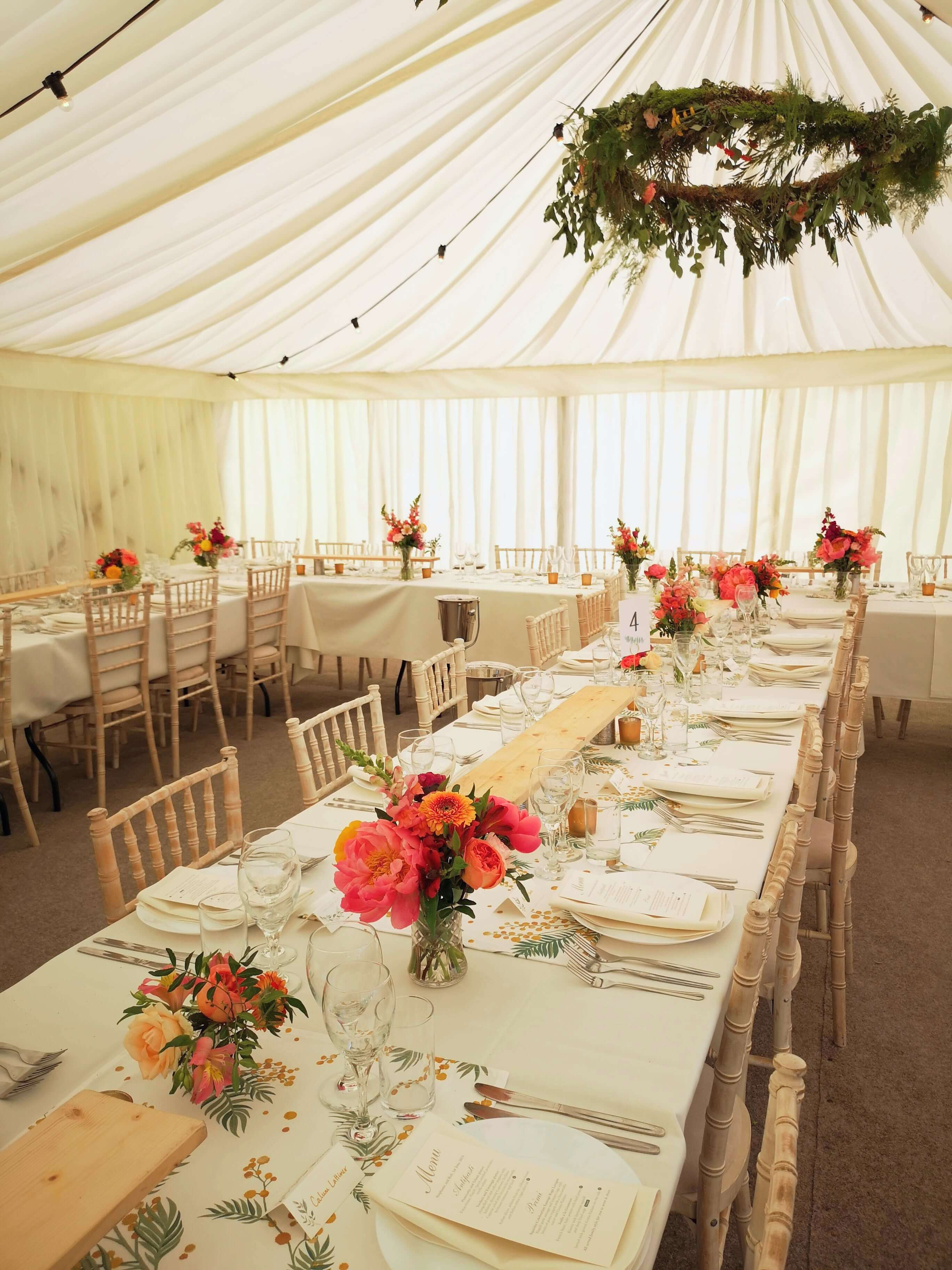 Glynde place marquee wedding with hanging floral hoops by Bettie Rose Flowers, Sussex wedding florist