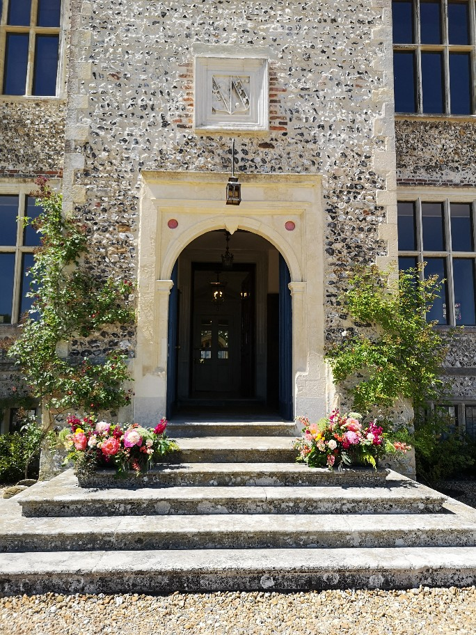 Glynde Place Wedding, entrance steps with flower arrangements