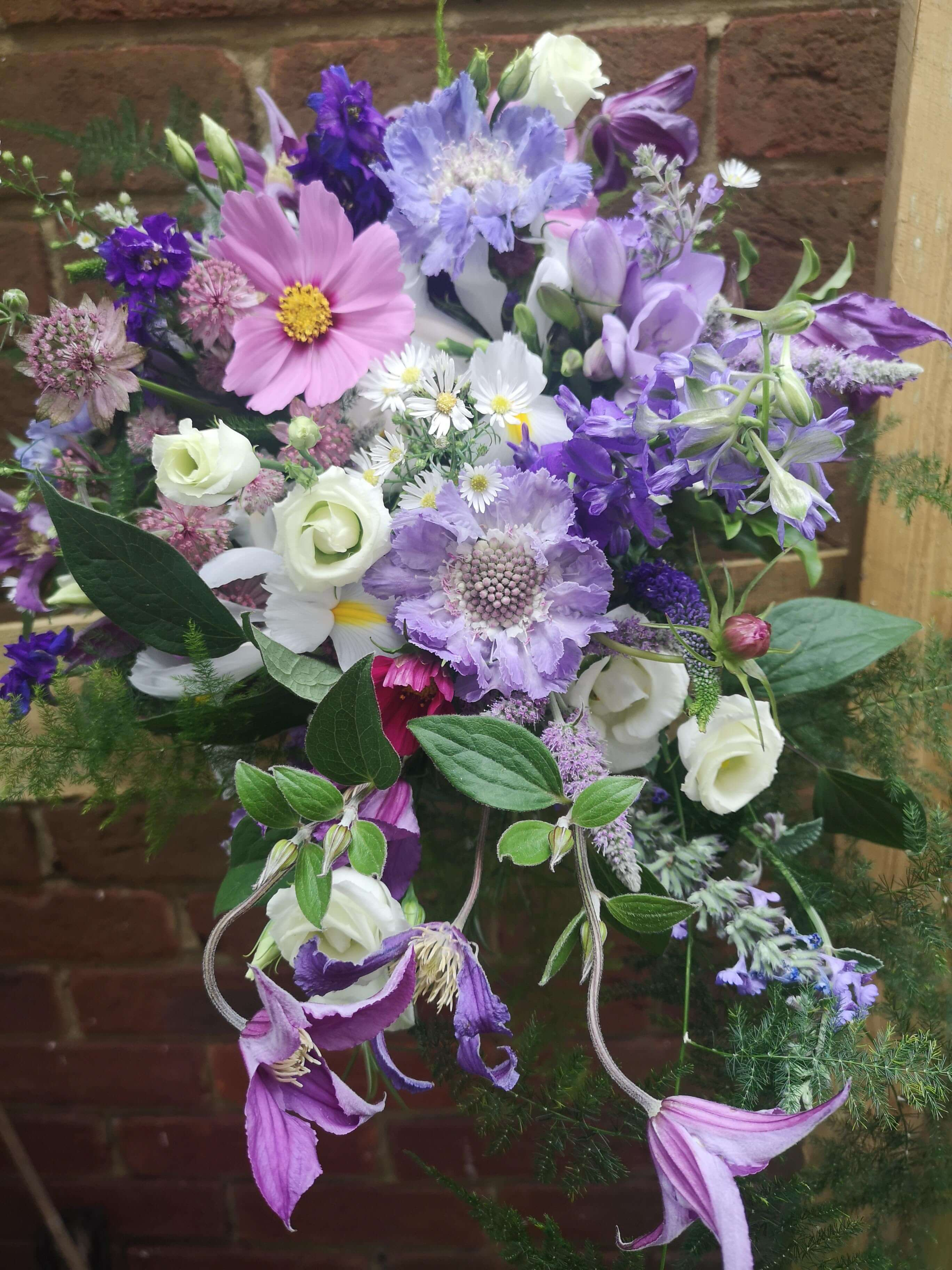 purple and lilac trailing bridal bouquet