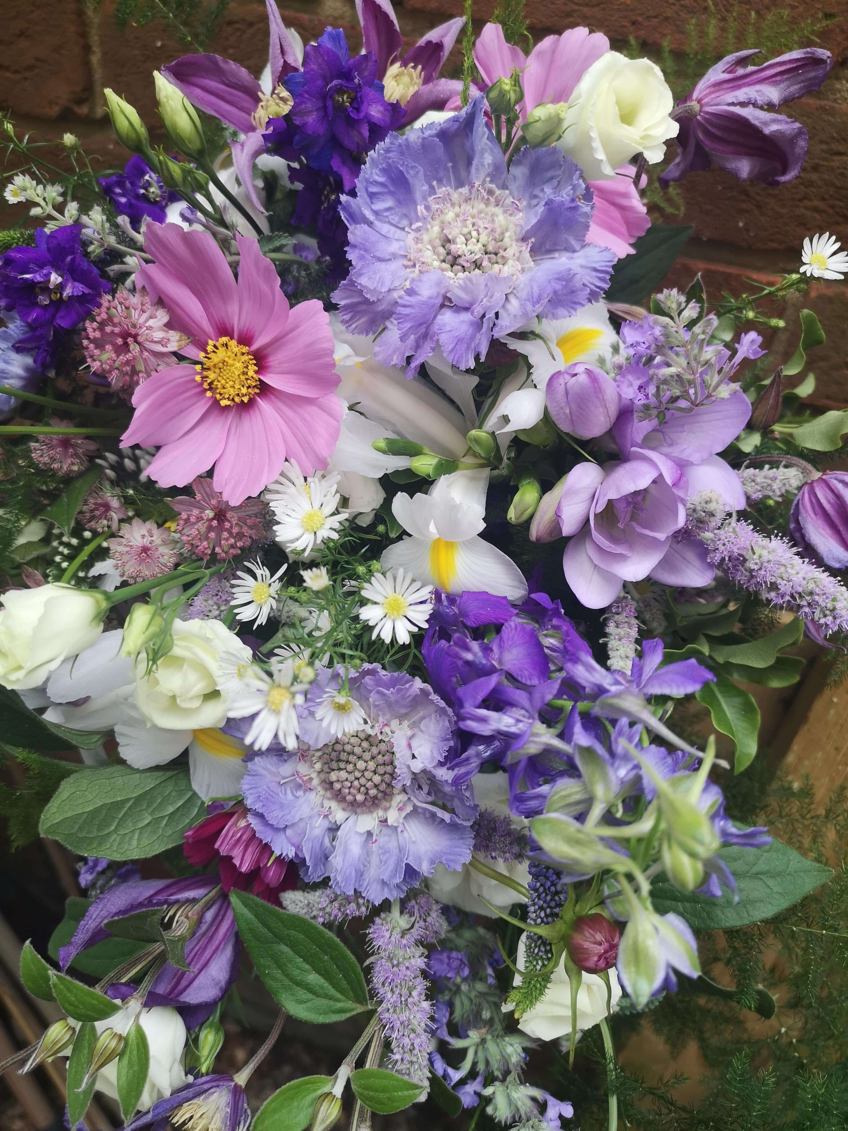 garden flower bridal bouquet in purples and lilacs